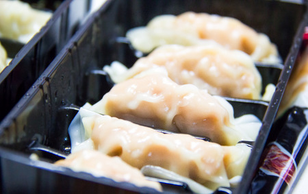 potstickers: Gyoza in the  black tray ( Small Depth of field)