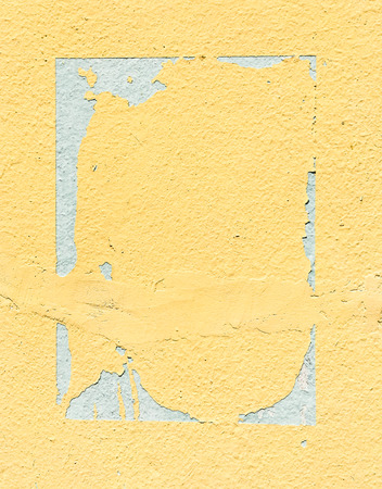 frayed: frayed yellow cement wall