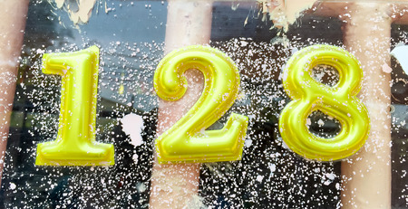 number 128 on the wall Stock Photo - 38095893