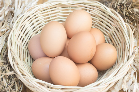 Eggs in the basket with straw