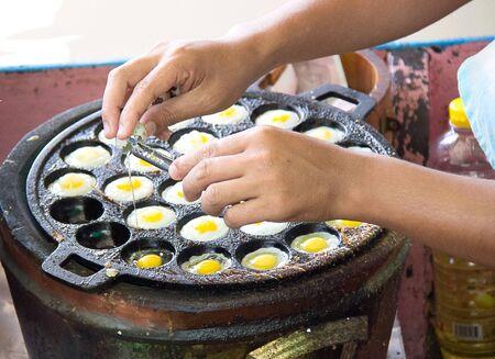 wachteleier: Quail eggs fried in the plate .