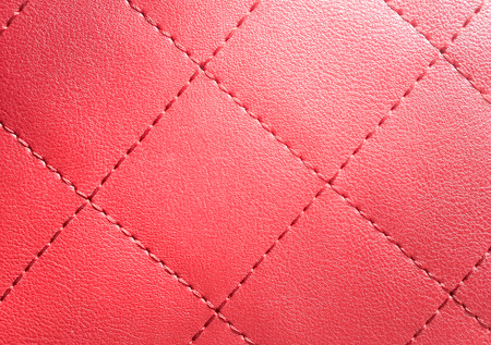 stitch: Red stitch on the red pellicle Stock Photo