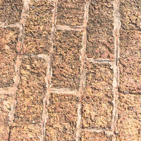 porous brick: Rough porous grunge brick texture background