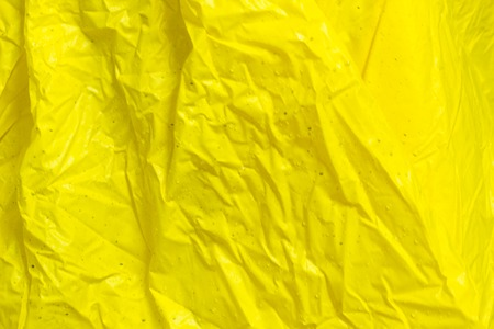 severely: yellow wrinkled plastic fabric