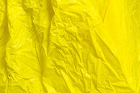 scruffy: yellow wrinkled plastic fabric