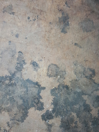 stain: black oil stain on the cement floor texture background Stock Photo