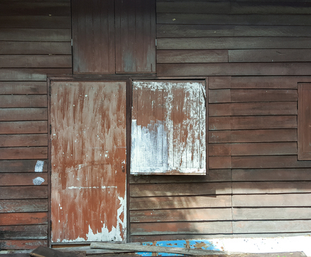 unsanitary: grunge old door and window texture background