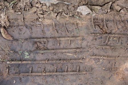 trace: trace tire car on the wet soil texture