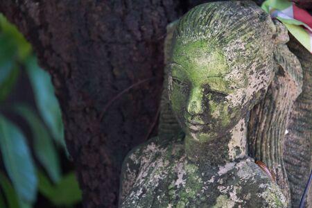 unsanitary: grunge old woman statue