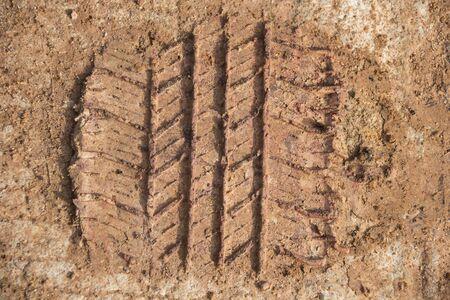 mini farm: mini-tractor trace on dry soil