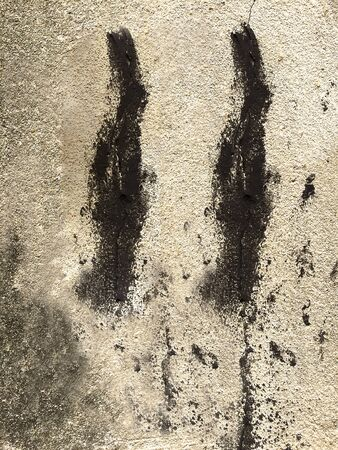stain: black stain on concrete wall Stock Photo