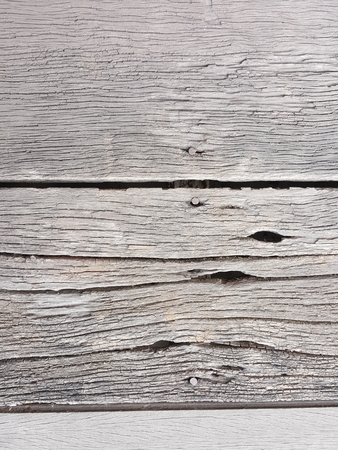 rough old splat wood floor texture with rusty nail Stock Photo