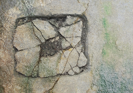 crack concrete with green lichen texure Stock Photo