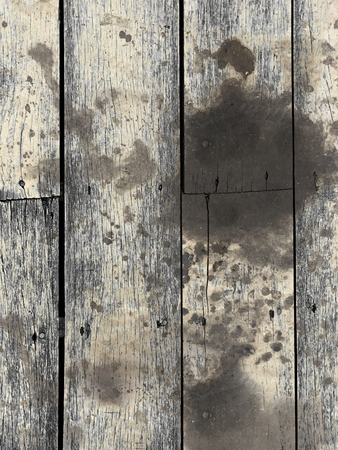 dirty black oil stain on vertical wood texture