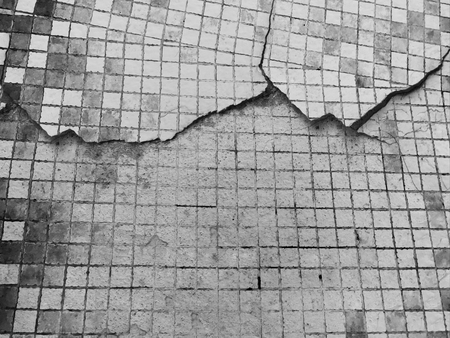 crack old square small tile on concrete floor texture