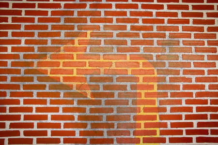 left arrow stain on brick wall texture Stock Photo