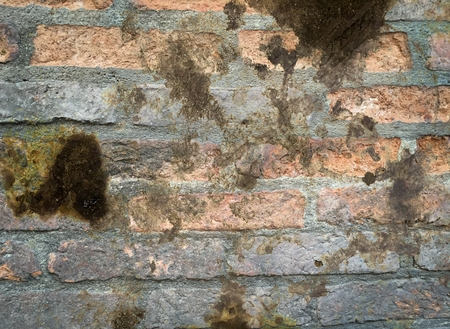 black oil stain on old brick wall texture
