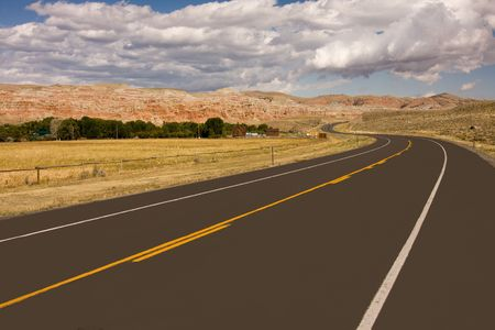 Empty highway in desert, Wyoming, USA Stock Photo