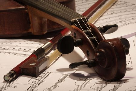 Old master violin with bow and note background