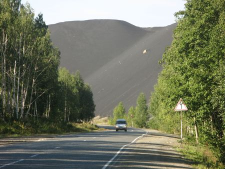 cuprite: Metal pollution - black mountains of slag from refined copper in one of the most polluted towns in the world. Karabash, Russia