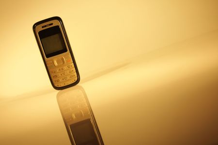Cell phone on abstract brown background photo