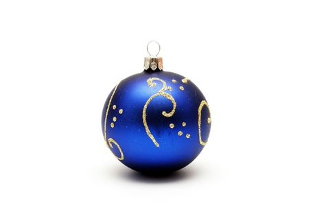 Dark blue christmas ball with gold pattern isolated on white background