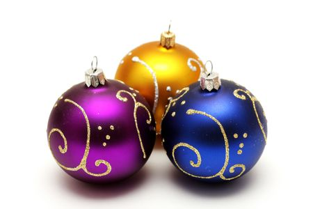 Gold, purple and dark blue christmas balls with gold pattern isolated on white background