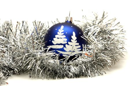 blue ball with christmas tree on silver tinsel isolated on white photo