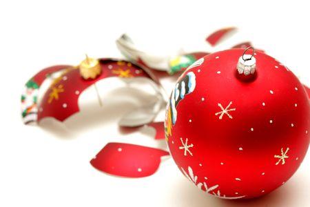 Smashed red christmas ball isolated on white background photo