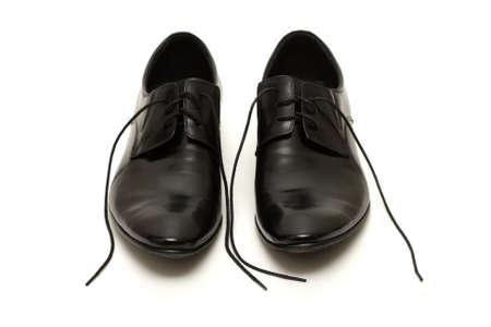 untied: Zapatos de cl�sico brillantes hombres negros con cordones no ligadas Foto de archivo