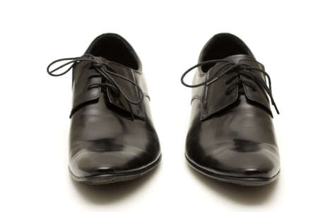 Classic shiny black mens shoes in confuse photo