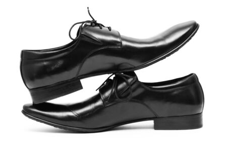 Classic shiny black men's shoes standing on each other Stock Photo - 6012381