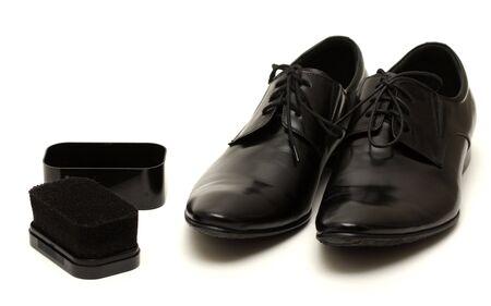 Classic shiny black men's shoes with sponge isolated on white Stock Photo - 6012395