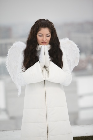 Angel on the roof in cold winter photo