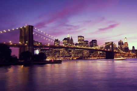 city park skyline: Brooklyn Bridge and Manhattan at sunset, New York