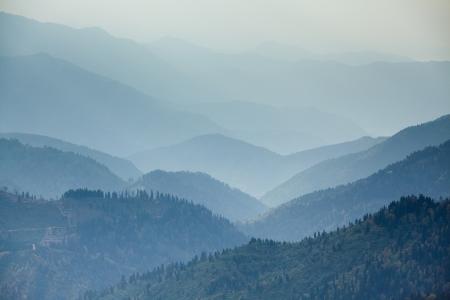 Mountains range in mist Stock Photo - 17024728