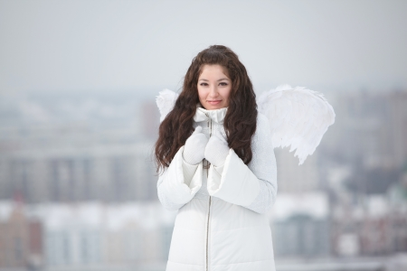 Young woman with angel wings photo