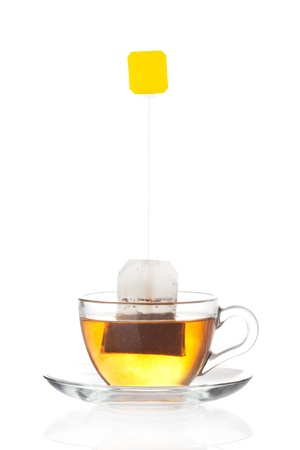 Cup of tea with tea bag  blank label  inside isolated on white background photo