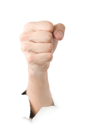 Human showing fist through the paper on white background photo