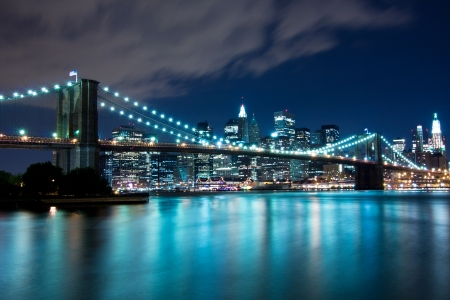 Brooklyn Bridge and Manhattan, New York, night scene Фото со стока