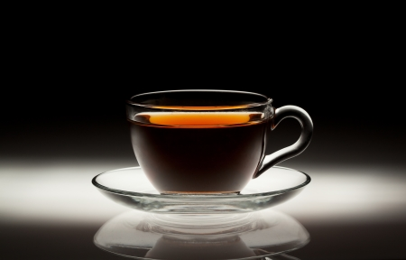 Tea cup on abstract dark background
