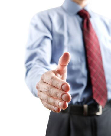 Businessman gesturing a handshake isolated on white background photo