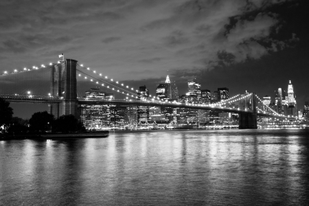 manhattan: Brooklyn Bridge and Manhattan at night  Black and white