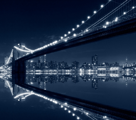 New York City, Brooklyn Bridge with reflections on water photo