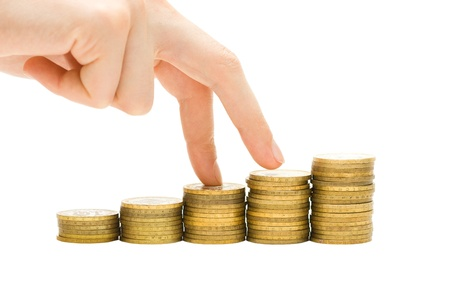 Economics growth concept - profit goes up  Hand and coins isolated on white Stock Photo