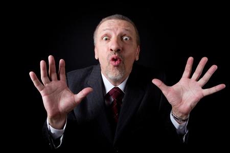 half dressed: Scared mature businessman looking at camera