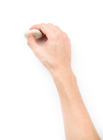 Human s hand erasing something on white background