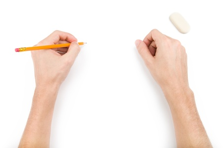 Left-hander with pencil writing something  Isolated on white