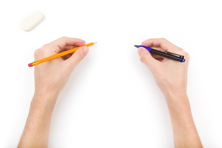 hand holding pen: Human with pen, pencil and eraser writing