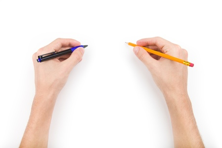 holding close: Human hands with pen and pencil with space for text
